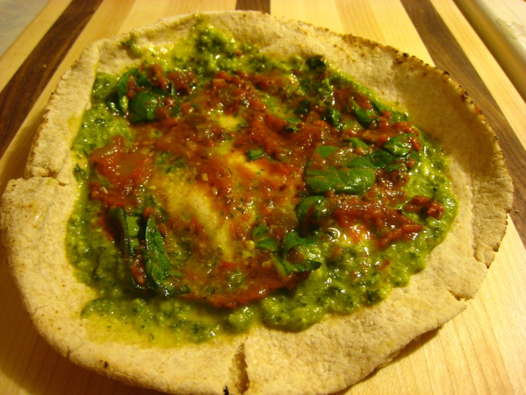 with pesto, spinach and tomato sauce reduction