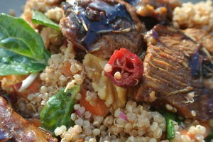 Roasted lamb with , balsamic quinoa salad with cranberries and walnuts, and a green salad