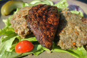 Sunflower seed burgers with grilled balsamic portabello mushrooms and a green salad