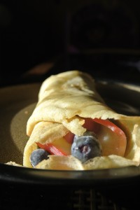 We filled these beautiful crepes with blueberries, steamed apple slices, roasted sunflower seeds, blueberry coconut yogurt, and topped it with maple syrup.