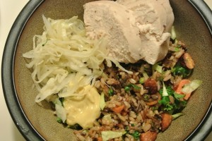 Whole roasted chicken, warm wild rice salad with roasted almonds and tamari sauce, homemade sauerkraut and dijon mustard.